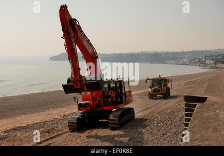 Earth moving equipment on the beach. - Stock Photo
