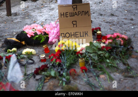 Donetsk, Ukraine. 24th Jan, 2015. Candles and flowers at the tragedy site in Donetsk's Bosse neighborhood. The Donetsk - Stock Photo