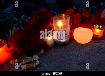 Donetsk, Ukraine. 24th Jan, 2015. Candles and flowers at the tragedy site in Donetsk's Bosse neighborhood. People - Stock Photo