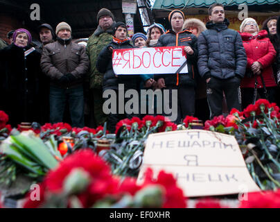 Donetsk, Ukraine. 24th Jan, 2015. People mourn victims of the public transport stop shelling during a rally titled - Stock Photo