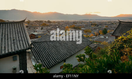 Lijiang Old Town mountain top view at sunrise with local historical architectures - Stock Photo
