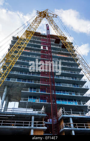 Miami Beach Florida Ocean Drive under construction site building crane hotel condominium - Stock Photo