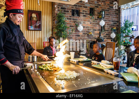 Orlando Florida International Drive Oishi Japanese Hibachi & Sushi Restaurant restaurant inside Asian man chef preparing - Stock Photo