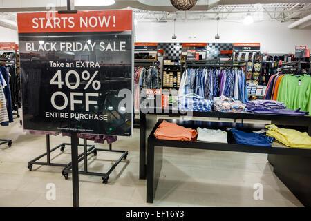 Orlando Florida Orlando International Premium Outlets shopping sale display Saks Off 5th Avenue clothing sign promotion - Stock Photo