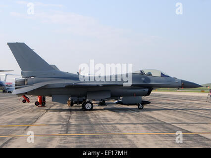 Modern fighter jet airplane on the ground  side view F-16 - Stock Photo