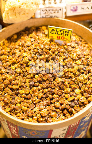 Mix of different raisins in big basket on the market - Stock Photo