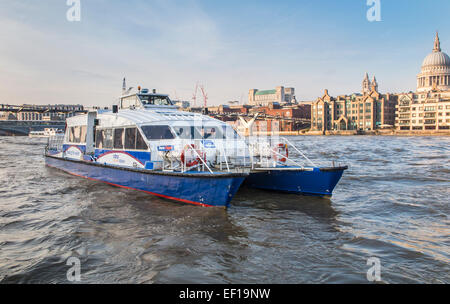 Catamaran Thames Clipper boat forming part of the river bus service, approaching Bankside Pier, St Paul's in the - Stock Photo
