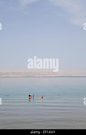 Relaxing in the dead sea. - Stock Photo