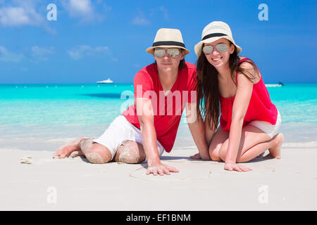 Close up of couple on tropical white beach - Stock Photo