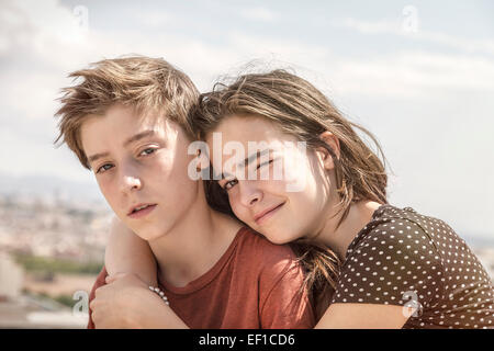 sister hugging her brother, toned image - Stock Photo