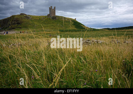 Dunstanburgh Castle on the Northumberland coast. - Stock Photo