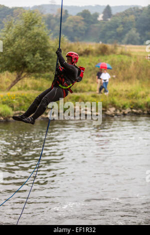 DLRG - German life saving associsation, lifeguards, rescue swimming, abseiling of rescue swimmers into river Ruhr, - Stock Photo