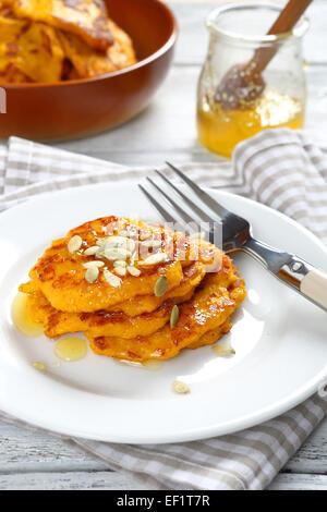 Sweet pumpkin pancakes on a plate, food - Stock Photo