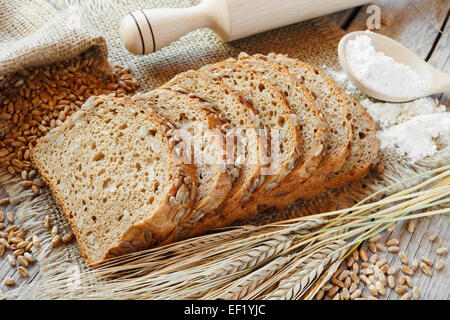 bread slices and rye ears on table - Stock Photo