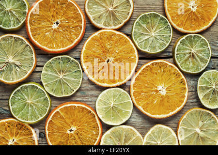 Dried orange and lemon slices on wooden table. Top view.