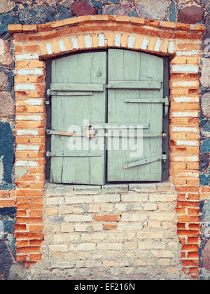 closed rustic window of old  house - Stock Photo