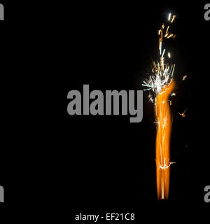 Burning Firework Sparkler Detail  isolated on black with huge copy-space, square - Stock Photo