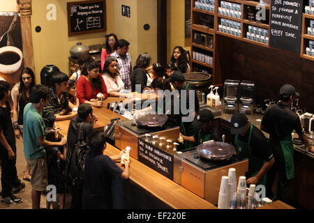 Customers wait for coffee at a Starbucks in New Delhi, India, 16 November 2012. For two years Starbucks in India - Stock Photo