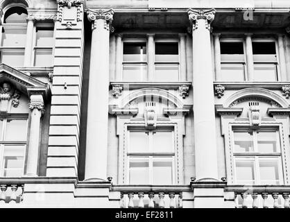 Details of pillars and windows in a well preserved building in the UK - Stock Photo