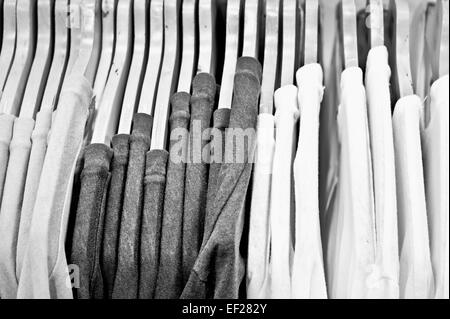 Casual male tops hanging in a store - Stock Photo
