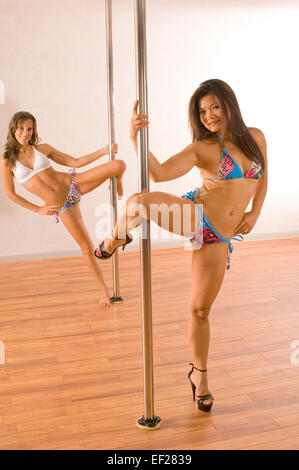 Two female pole dancers - Stock Photo