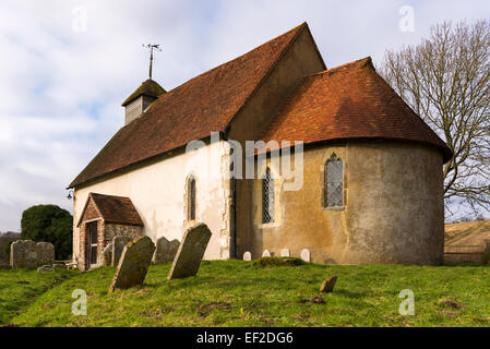 The church of st mary the virgin at Upwaltham nestling in the south downs on a grey winters day - Stock Photo