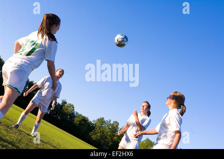 Girls playing soccer - Stock Photo