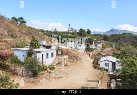 Cuban lifestyle: Whitewashed houses and homesteads in a small poor village accessed by an unmade dirt track, near - Stock Photo