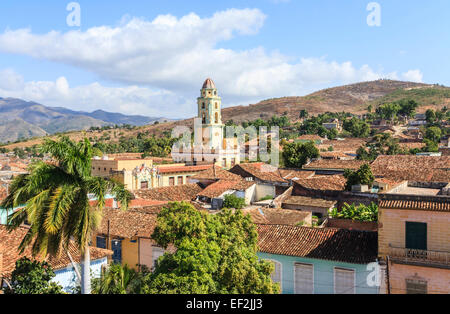 Panoramic landscape: terracotta tiled rooftop view over Trinidad, Cuba with Iglesia Parroquial de la Santísima (Church - Stock Photo