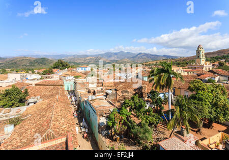 Panoramic terracotta tiled rooftop view over Trinidad, Cuba with Iglesia Parroquial de la Santísima Trinidad (Church - Stock Photo