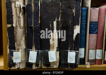 Frayed spine of old books on library shelf - USA - Stock Photo