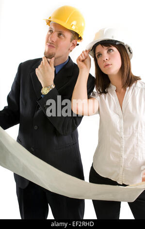 Two architects looking at blueprints - Stock Photo