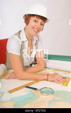 Woman making measurements on a map - Stock Photo