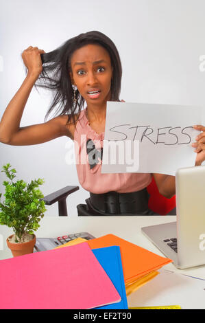 Stressed businesswoman pulling out her hair - Stock Photo