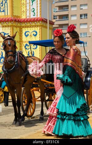 Flamenco dancers at the Feria de Abril, Seville, Andalucía, Spain