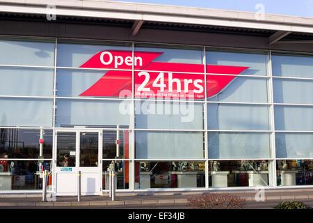 Tesco Extra Supermarket open 24 hours sign - Stock Photo