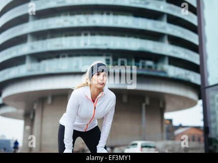 Young woman on sports exercising workout outdoor. Female fitness athlete working out for healthy lifestyle. Female - Stock Photo
