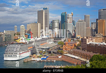 Cruise ship Carnival Spirit at Sydney harbour and city with its colonial buildings and skyscrapers, New South Wales, - Stock Photo