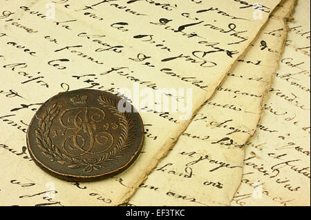 Ancient manuscript  and coin - Stock Photo