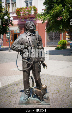 Monument of Happy Chimney Sweeper with cat - Stock Photo