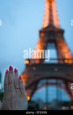Girl holds her hand with a gold ring - Stock Photo