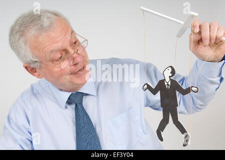 Man playing with a puppet - Stock Photo