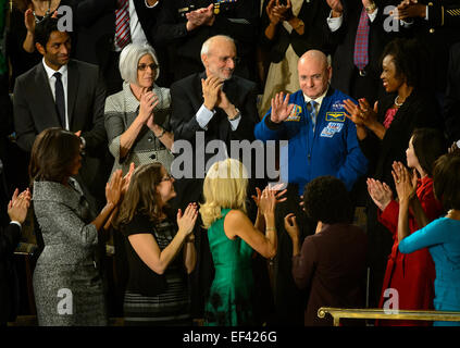 NASA astronaut Scott Kelly stands as he is recognized by President Barack Obama, while First lady Michelle Obama, - Stock Photo