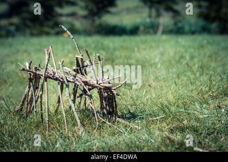 grass caban hut wood sticks little - Stock Photo
