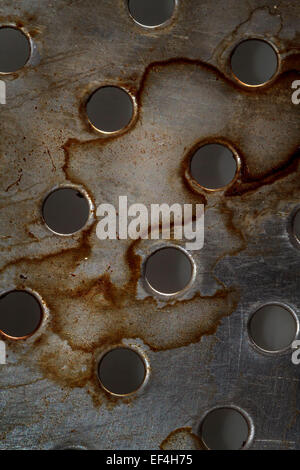 metal texture with holes, abstract background - Stock Photo