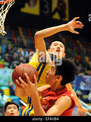 Hong Kong, China. 27th Jan, 2015. Chanatip Jakrawan (front) of Thailand makes a shot during the Super Kung Sheung - Stock Photo