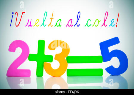 sentence vuelta al cole, back to school in spanish, and the equation two plus three are five with numbers of different - Stock Photo