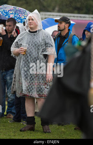 Two men dressed in kilts and rain ponchos during events at Bannockburn Live, at Bannockburn, Stirlingshire. - Stock Photo