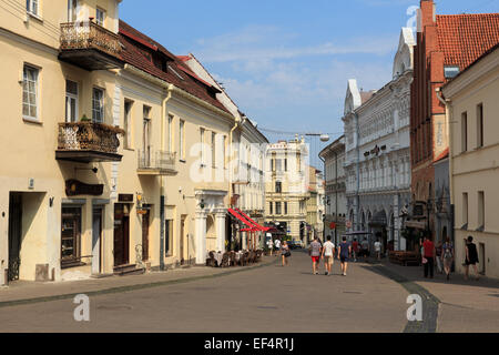 People walking on the street in Old Town of Vilnius. Weather is sunny and warm. - Stock Photo