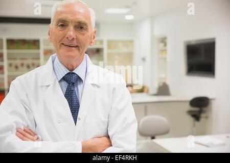 Science professor smiling at camera - Stock Photo